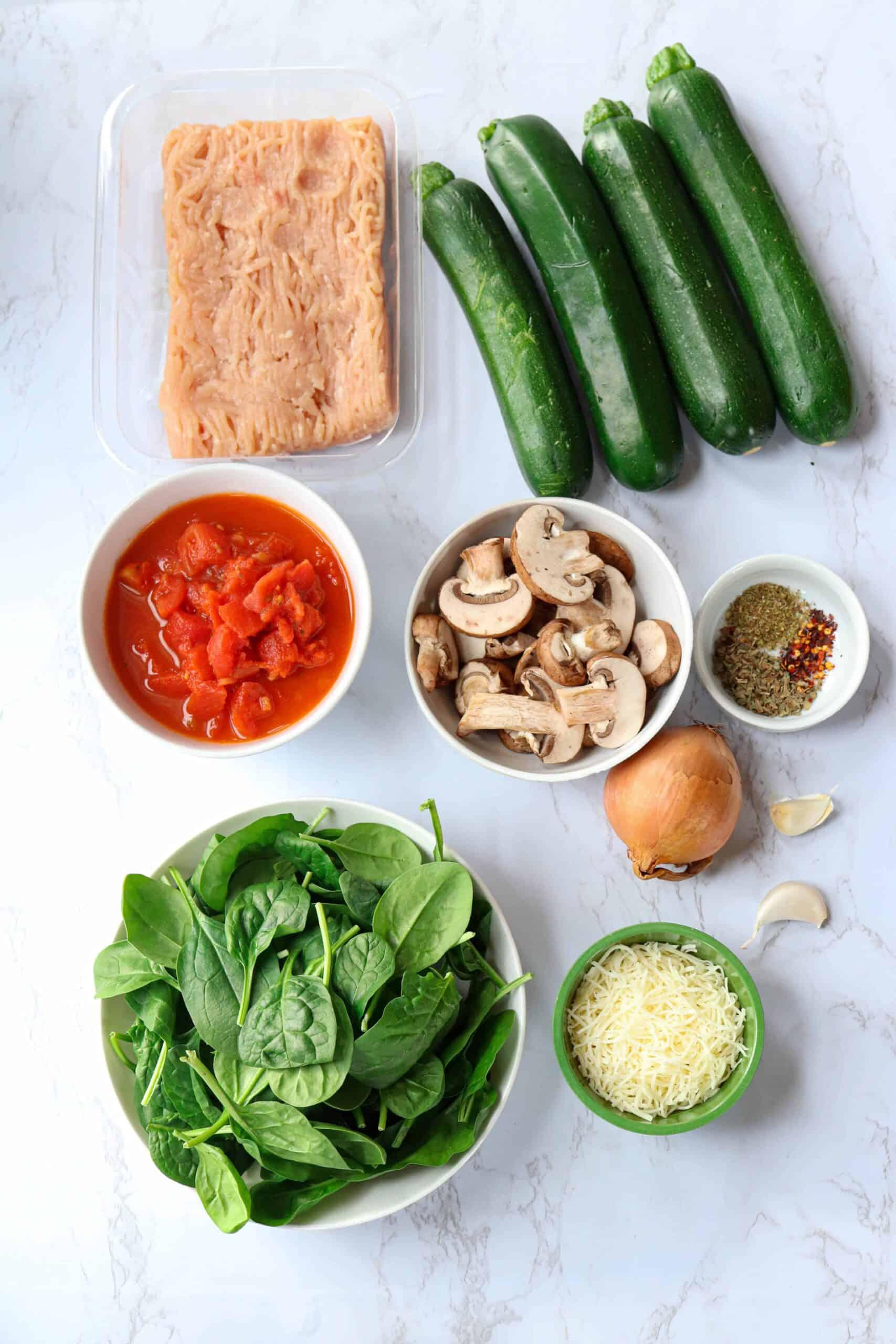 ground chicken, fresh spinach, mushrooms, four zucchini, spices, cheese, onion and garlic