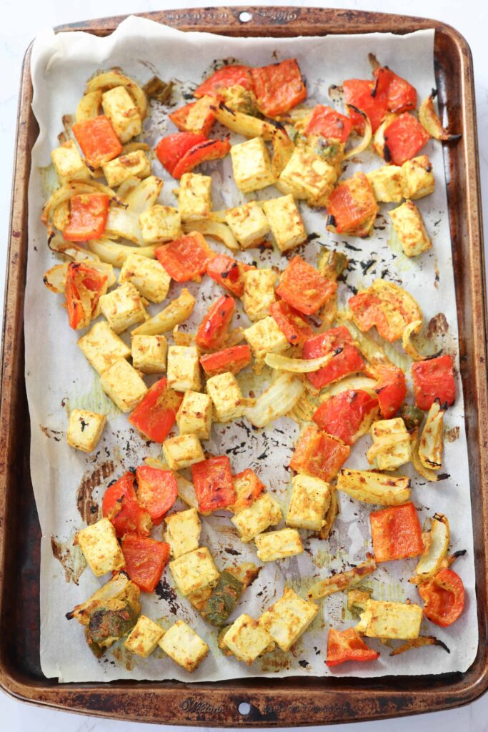 tofu, peppers and onions baked on a sheet pan