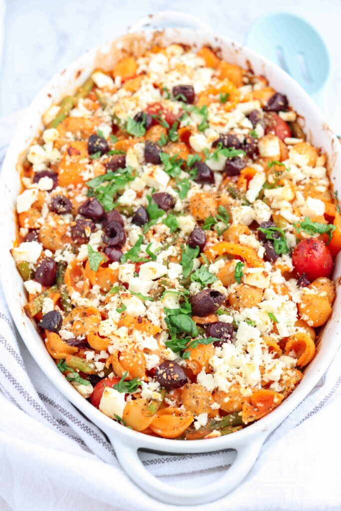 baked creamy pasta with veggies, feta and olives
