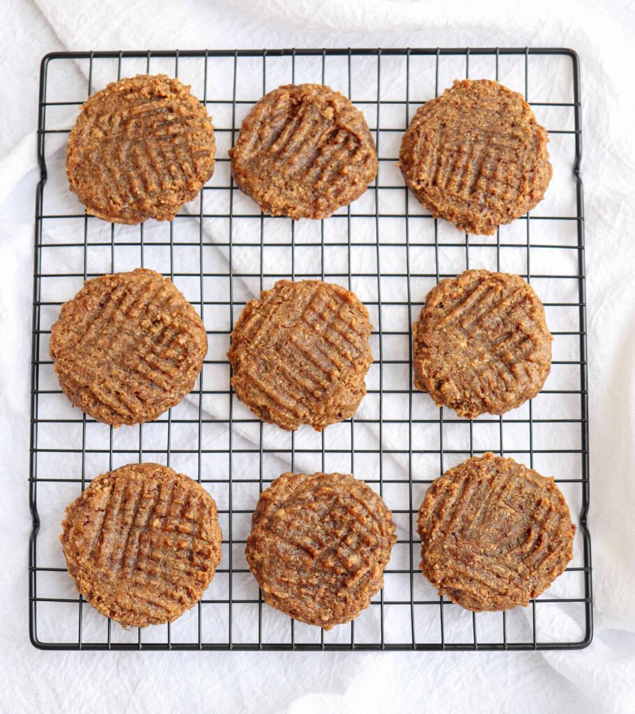none flourless peanut butter banana cookies on a cooling rack