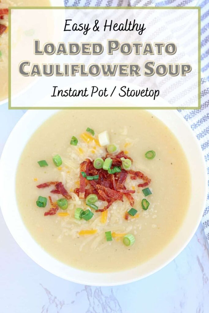 a bowl of creamy potato cauliflower soup with bacon bits, grated cheese and scallions pin with title