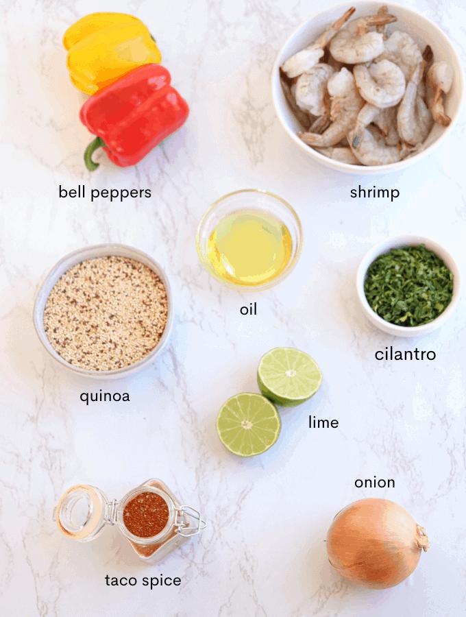 shrimp fajita bowl ingredients laid out on white counter
