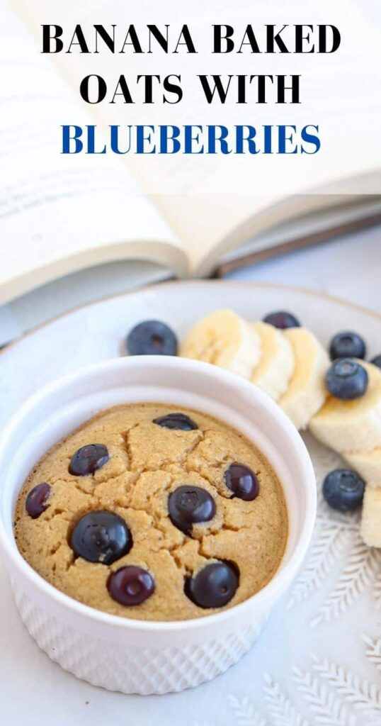 banana baked oats with blueberries in a ramekin with title on top