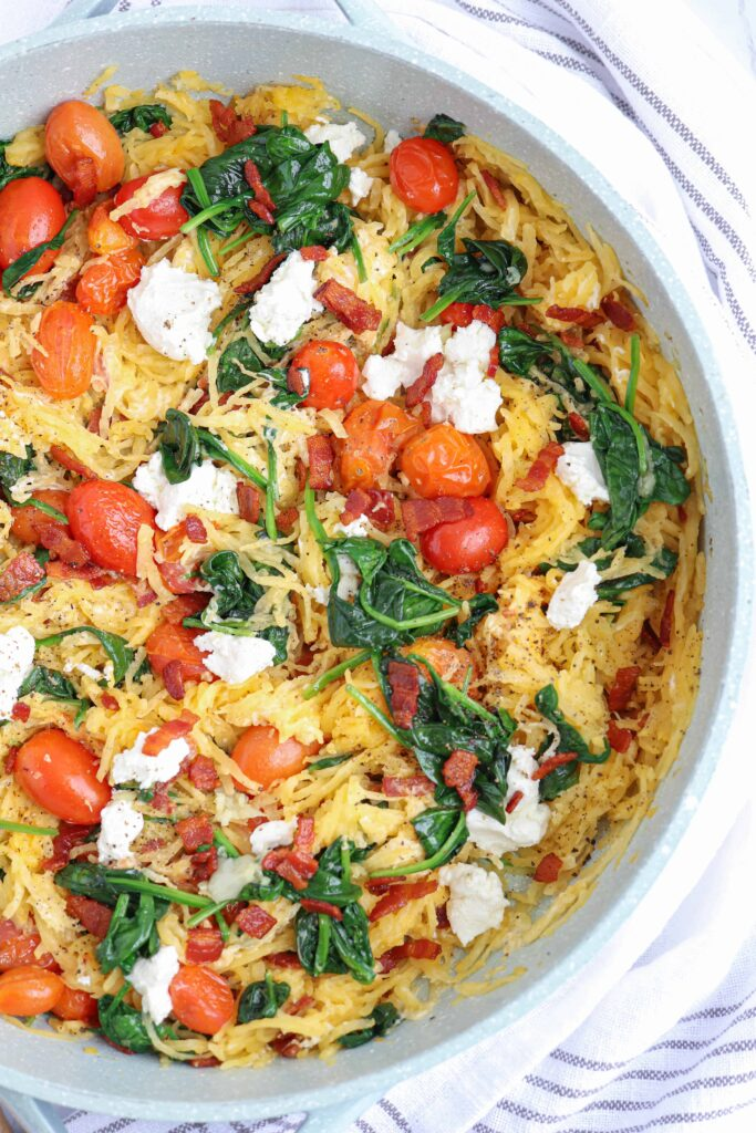 spaghetti squash with goat cheese, tomatoes, spinach and bacon