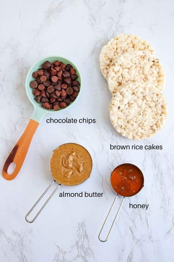 chocolate almond butter rice cups ingredients on white marble surface