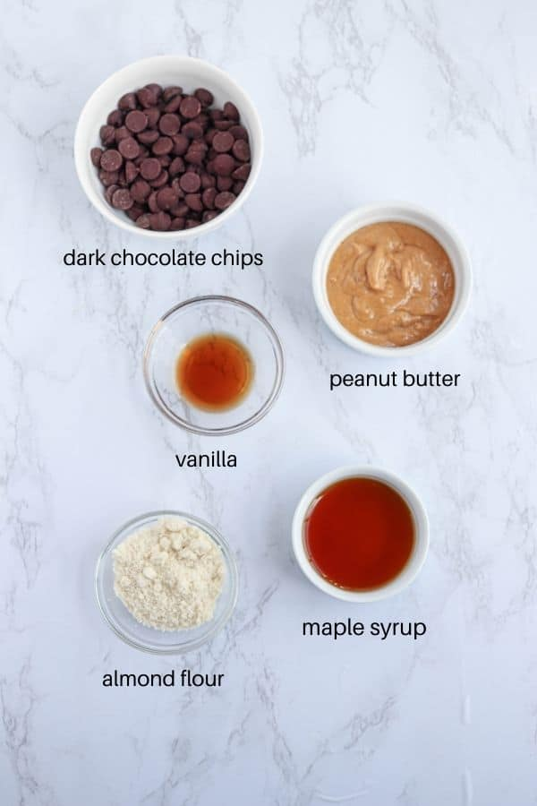 peanut butter eggs ingredients on white marble countertop