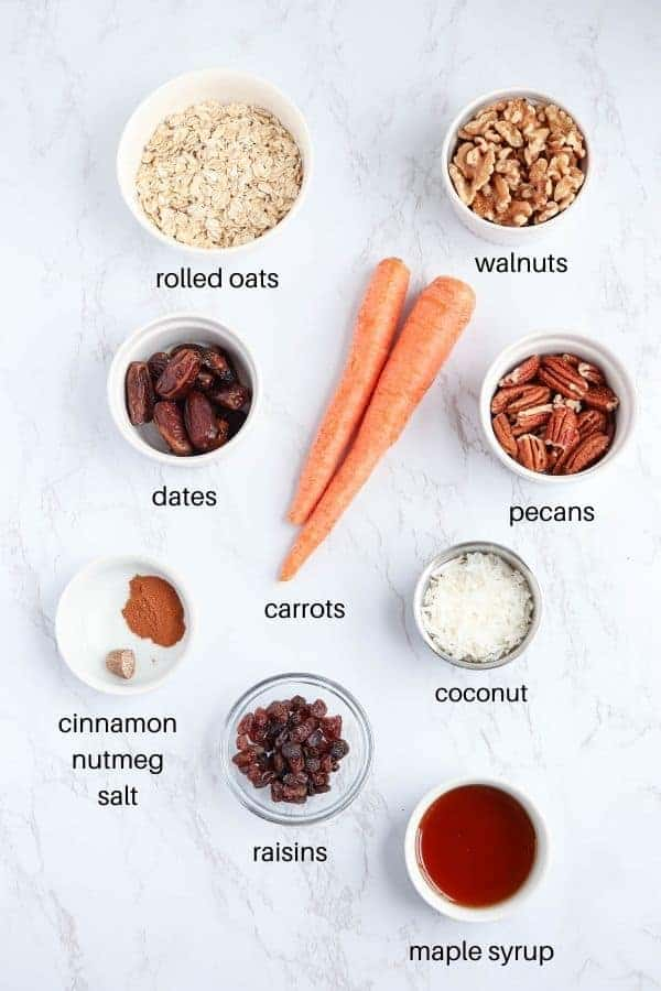 carrot cake bars ingredients on white marble background