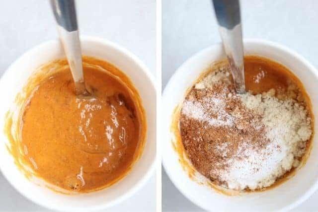 pumpkin mug cake batter in a white mug being stirred with a spoon
