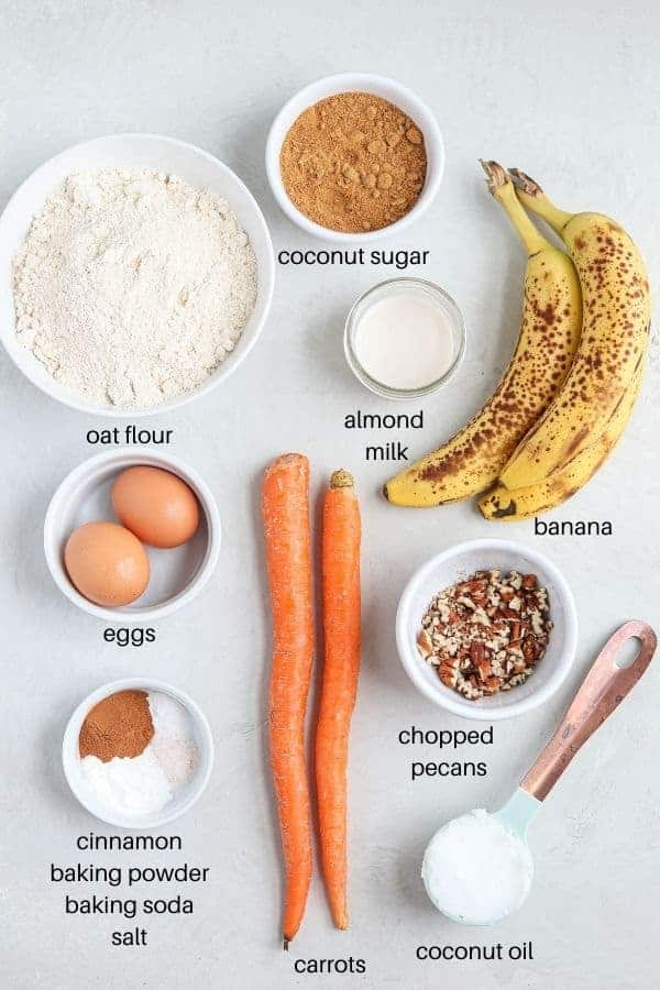 banana carrot oat muffin ingredients laid out on gray surface with labels